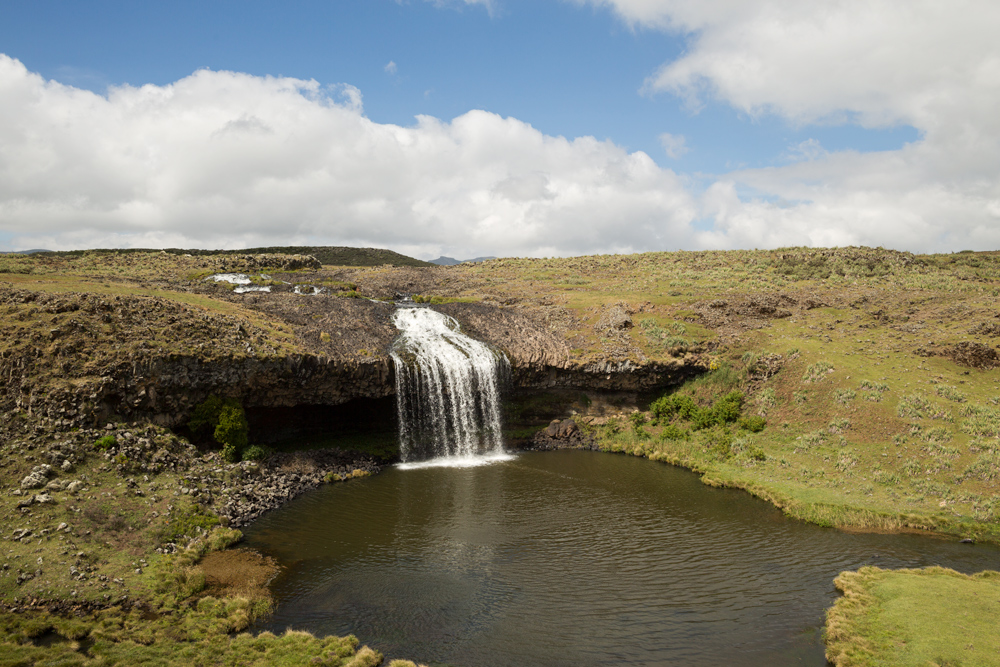 Image of a waterfall and a lake in the alpine landscape of the Bale Mountains