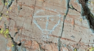 "Front view of the petroglyph called ""The Christ"" reproducing a human head"