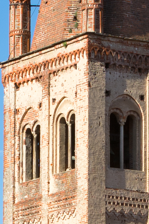 Close view of the bell tower of Saint John's church in Saluzzo seen from an alley near the town's belfry