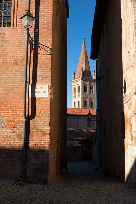 Bell tower of Saint John church in Saluzzo seen from an alley near the town's belfry
