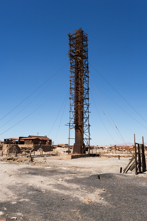 Rusted smokestack of the furnaces where the saltpeter minerals were cooked in Humberstone in the Atacama Desert of Chile