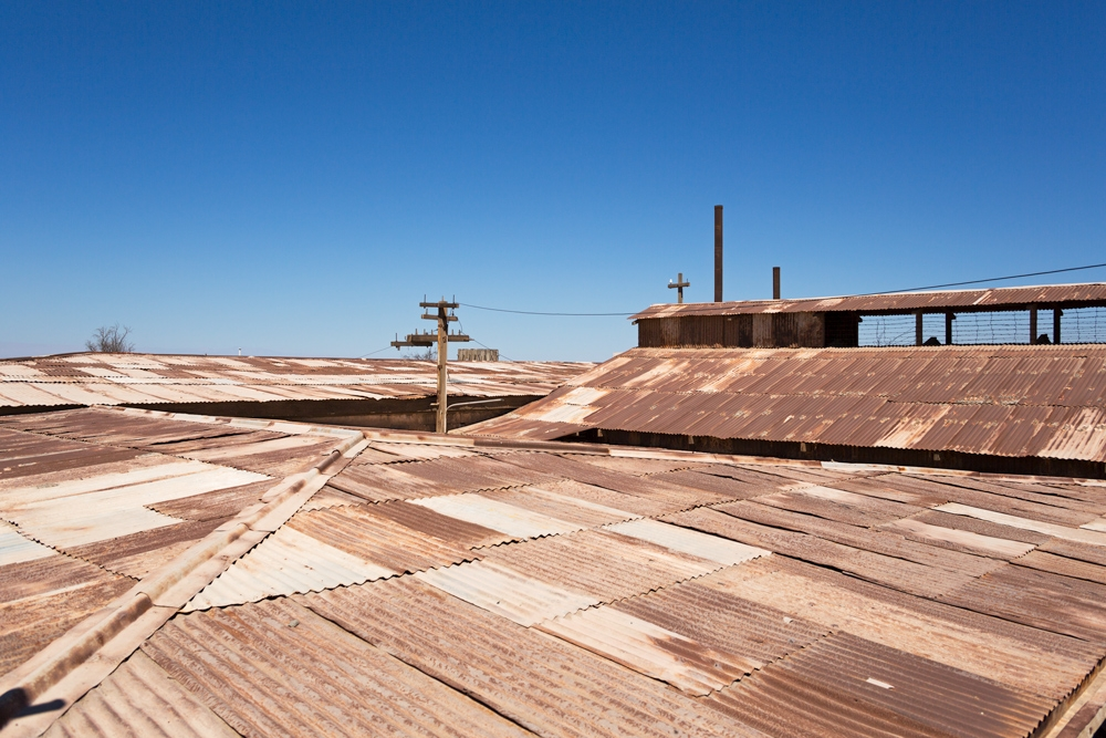 Building roofs in Humberstone made of corrugated iron rusting in the clear sky of the Atacama Desert