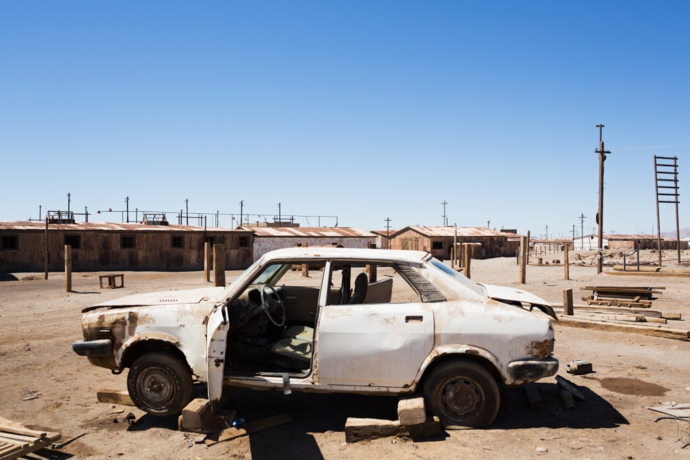 Abandoned car in a road in the old town of Humberstone in Chile
